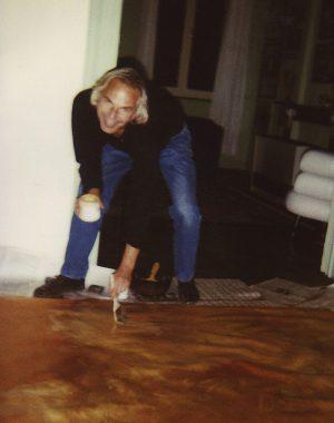 <p>Ivan Adriaens paints the golden background.</p>