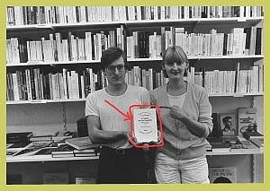 """<p>1984: me and Johan with the book """"L'idiot de la famille"""" by J.P.Sartre, an allusion of the photograph by artist Jan Vercruysse, who worked in the bookshop before I took it over.</p>"""